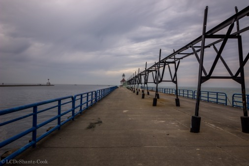 pier, railing, catwalk, lighthouse in distance
