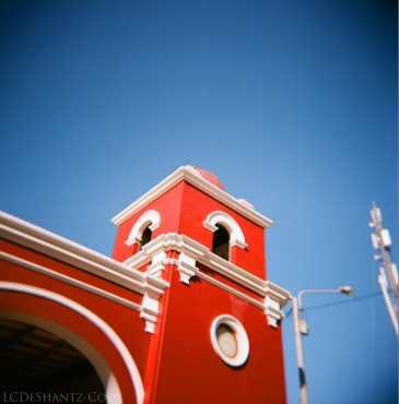 red building against blue sky in Huacachina, Kodak Ektar 100